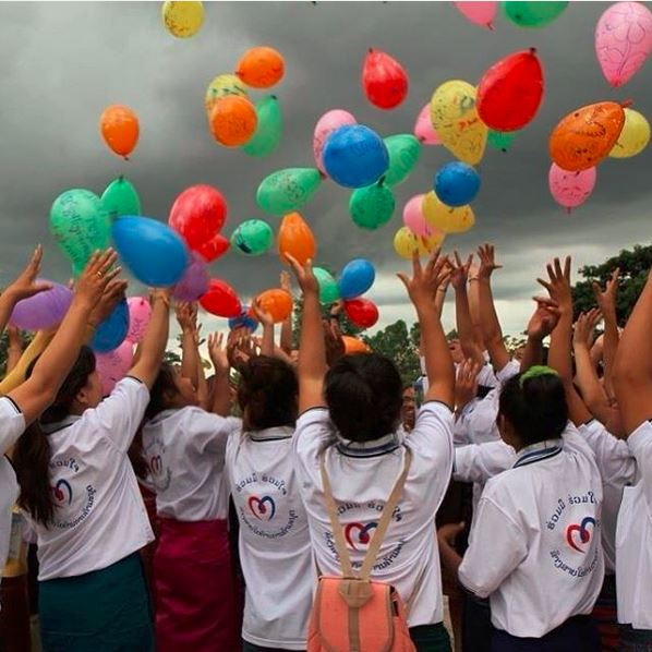 In Laos, Australian aid, in partnership with World Vision is working with survivors of human trafficking to help them reintegrate into their communities. These survivors have written messages to their friends and family on balloons. Photo by Nila Douanesouvanh, World Vision.