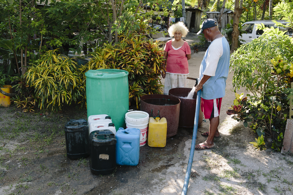 'Water Boy' water vendor delivers water to locals in Gereka. In times of drought, Water Boy prioritises large wealthier clients over the poor. Port Morseby, Papua New Guinea.